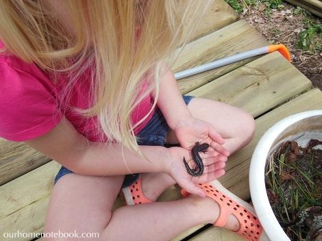 Emma holding a salamander