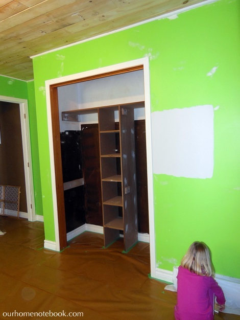 Kids Room Makeover - Taping brown paper to protect floor