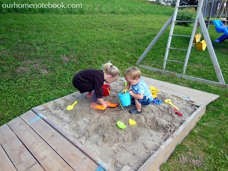 Building a Sandbox - Kids building in the sand