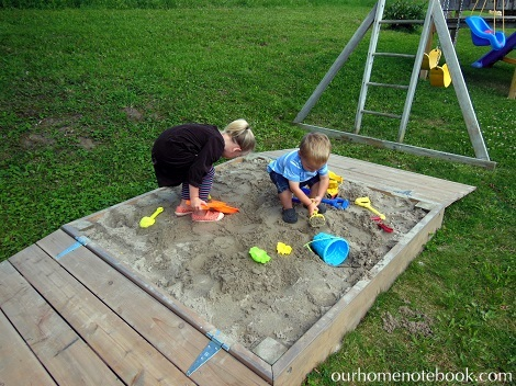 Building a Sandbox - Kids playing in the sand